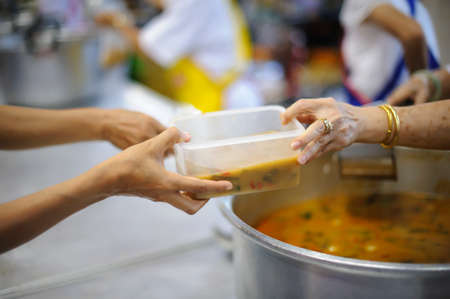 Photo for Free food for the poor and Food distribution - Royalty Free Image
