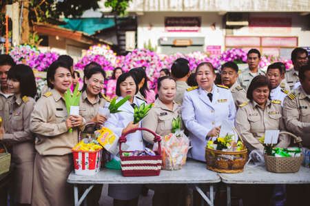 Chiang Mai, Thailand - OCTOBER 23, 2019: State enterprise employees in Saraphi District jointly offer food, drinks to Buddhist monks in Saraphi, Chiang Mai