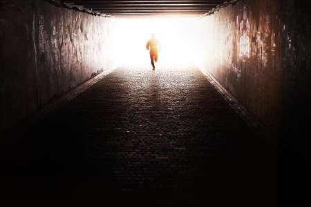 Photo pour Man running through the tunnel in the sun - image libre de droit