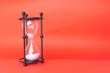 Photo pour Transparent hourglass, Blue background. Copy, text space. - image libre de droit