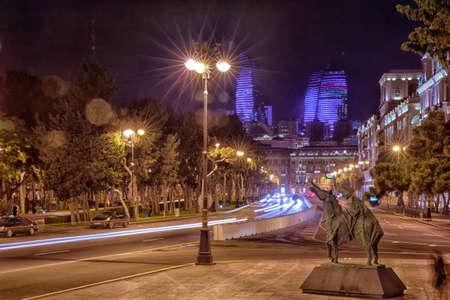 Bright Baku nights. Moment of time. Panoramic view of Baku. Night routes in Baku. Flame Towers . Night street traffic on Heydar Aliyev avenue. Baku, Azerbaijan