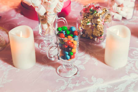 Photo pour Multi colored sweets . Colored candy in a glass . Round chocolate is very colorful - image libre de droit