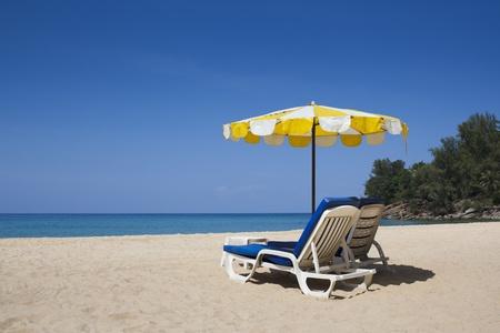 Sun umbrella and chairs on the Nai thon beach of Phuket island
