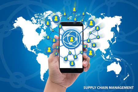Foto de hands holding the phone Supply Chain Management concept on blue background - Imagen libre de derechos