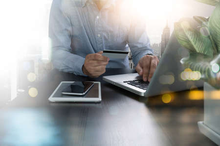 Photo pour man using laptop and holding credit card with as Online shopping concept - image libre de droit