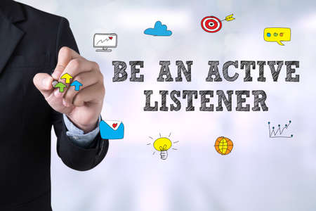 BE AN ACTIVE LISTENER Businessman drawing Landing Page on blurred abstract background