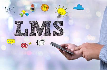 Photo pour LMS person holding a smartphone on blurred cityscape background - image libre de droit