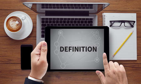 DEFINITION                     , on the tablet pc screen held by businessman hands - online, top view