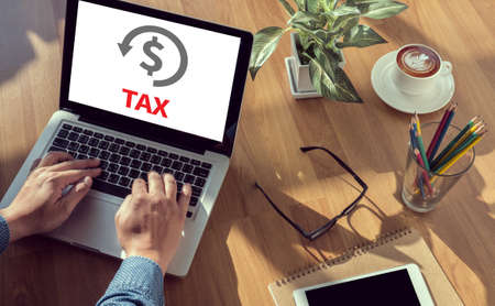 REFUND and Tax Refund Fine Duty Taxation  man hand on table Business, coffee, Split tone