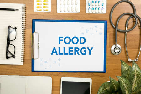 Photo pour FOOD ALLERGY Professional doctor use computer and medical equipment all around, desktop top view - image libre de droit