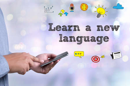 Learn a new language person holding a smartphone on blurred cityscape background