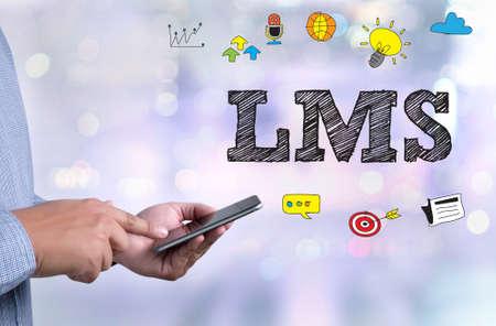 Foto für Learning Management System (LMS)  person holding a smartphone on blurred cityscape background - Lizenzfreies Bild