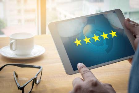 Foto de Businessman holding five star rating,Review, increase rating or ranking, evaluation and classification concept - Imagen libre de derechos