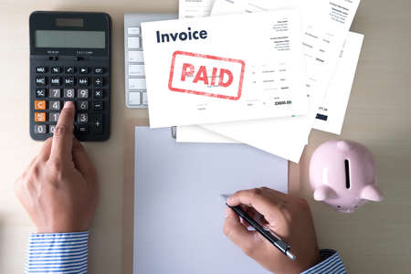 Photo pour Close-up man work Invoice Bill Paid Payment  At Office Invoice savings, finances bill - image libre de droit