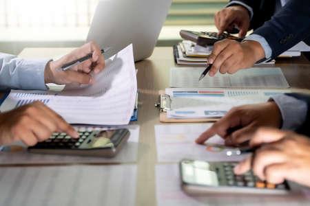 Foto de calculator finance accounting achievement to balance man assistant accounting analyzing financial document data charts and graphs - Imagen libre de derechos