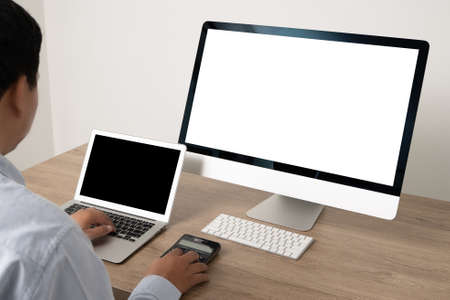 Photo pour young man working Businessman using a desktop computer of the blank screen - image libre de droit