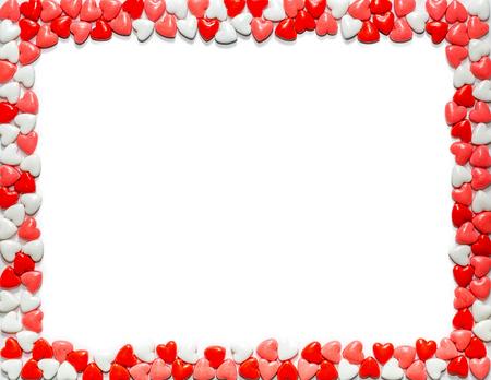 Foto de Heart shaped sweet Valentine's Day candy framing letter size white paper - Imagen libre de derechos