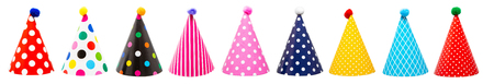 Photo pour Row of nine colorful festive birthday party hats with different patterns and pom-poms - image libre de droit