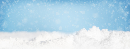 Photo for Snow piles on ground and falling in blue sky. - Royalty Free Image