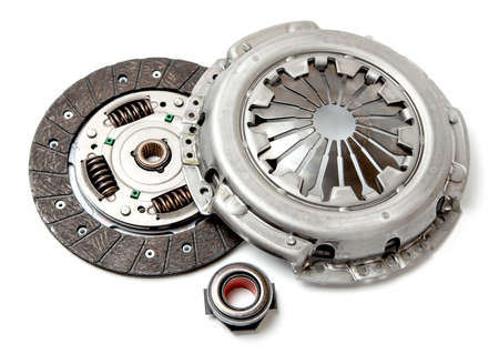 Photo pour Set of replacement automotive clutch isolated on white background. Disc and clutch basket with release bearing - image libre de droit