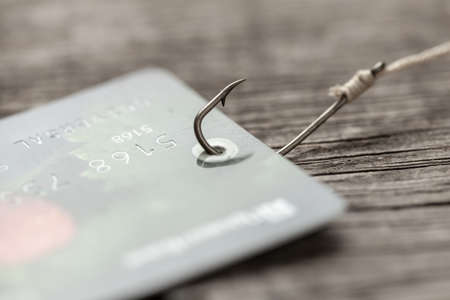 Photo pour Credit card on fishing hook. Credit with trick or hidden payments. Online fraud. - image libre de droit