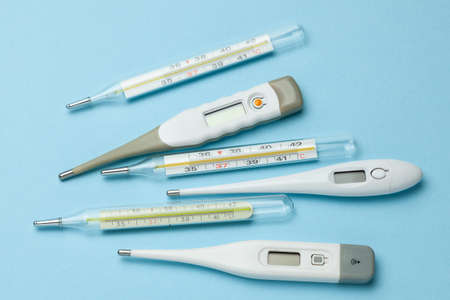 Photo for Medical thermometers glass and electronic on blue background. - Royalty Free Image