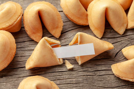 Photo pour Chinese fortune cookies. Cookies pile with blank blank inside for words prediction. Background of old wooden table - image libre de droit