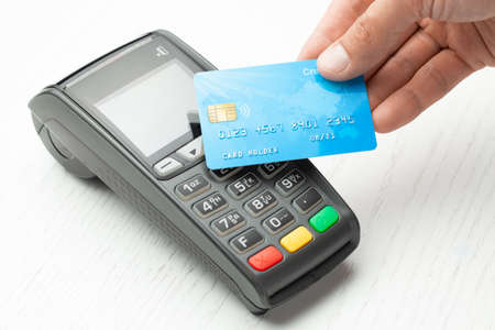 Photo for Contactless payment by credit card. POS terminal NFC payment. Concept of how to choose payment method for shopping in a store - Royalty Free Image