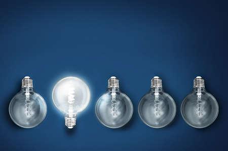 Photo pour creativity innovation illuminated light bulb row dim ones concept solution - image libre de droit
