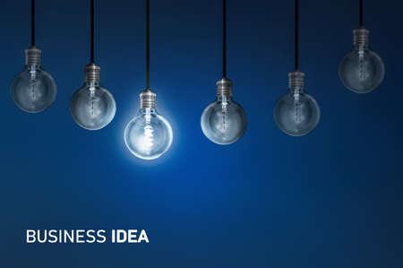 Photo for Business idea, creativity innovation illuminated light bulb row dim ones concept solution - Royalty Free Image