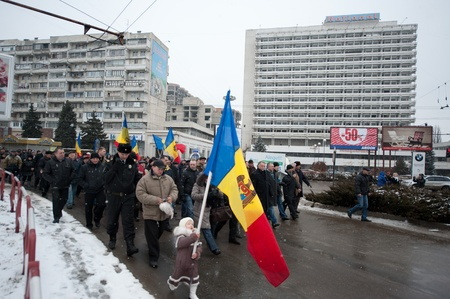 Holding a Moldovan flag, young Nastya marches in Chisinau, Moldova, at a protest against current administration.