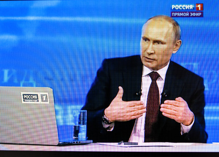 PARIS, FRANCE - APRIL 17, 2014: Russian President Vladimir Putin's annual televised call-in with the nation as seen on a digital display. Putin urged dialogue between Russia and Ukraine on APR 17, 2014