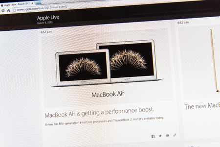 PARIS, FRANCE - MAR 9, 2015: Apple Computers event keynote tweets close up seen on iMac display with the newly updated Mc Book Air as seen on 9 March, 2015