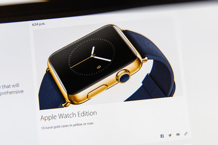 PARIS, FRANCE - MAR 9, 2015: Apple Computers event keynote tweets close up seen on iMac display with the newly launched Apple Watch 18-karat gold case as seen on 9 March, 2015