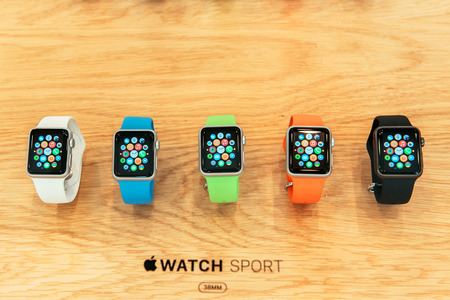 Photo pour PARIS, FRANCE – APR 10, 2015: New wearable computer Apple Watch smartwatch displaying the Sport edition collection. Apple Watch incorporates fitness tracking and health-oriented capabilities and  integration with iOS Apple products and services - image libre de droit