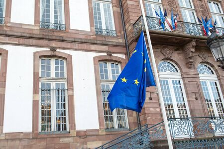 STRASBOURG, FRANCE - 14 Nov 2015: The European Union Flag flies at half-mast in front of the Strasbourg City Hall  following an terrorist attack in Paris