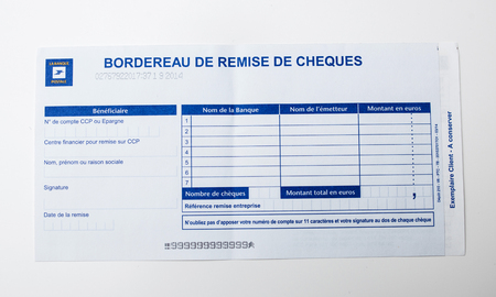PARIS, FRANCE - JANUARY 14, 2015: Bordereau de remise de cheques on white background issued by the Postal Bank of France - La Banque Postale