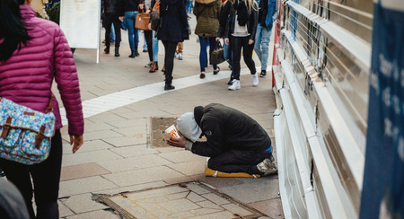 Photo for STRASBOURG, FRANCE - FEB 6, 2016: Beggar in the street of the European Capital - Strasbourg, Alsace, France - Royalty Free Image