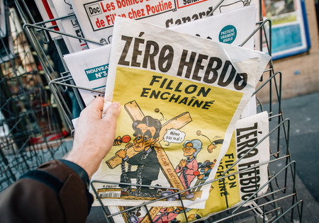 PARIS, FRANCE - MAR 23, 2017: Zero Hebdo satire magazine with caricature of Francois Fillon and text - Concatenated Fillon newspaper from press kiosk newsstand featuring headlines