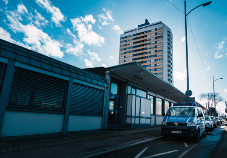 KEHL, GERMANY - FEB 3, 2017: German police station with Volkswagen police van parked in front and large German architecture apartment building in the background