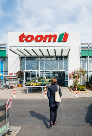 FRANKFURT, GERMANY - APR 1, 2017: Woman walking to the entrance of TOOM the German DIY-store chain offering home improvement and do-it-yourself goods - customers buying goods, selecting the best tools