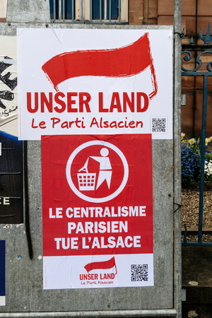 STRASBOURG, FRANCE - APR 23, 2017: Unsern Land - Le Centralisme Prisien tue l'Alsace translated as Parisian Centralism kills Alsace