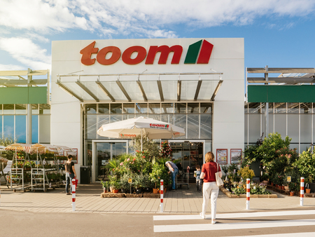 FRANKFURT, GERMANY - JUN 30, 2017: Woman walking to the entrance of TOOM Baumarkt the German DIY-store chain offering home improvement and do-it-yourself goods - customers buying goods, selecting the best tools