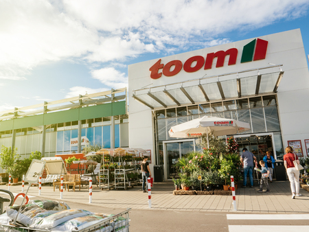 FRANKFURT, GERMANY - JUN 30, 2017: TOOM Baumarkt entrance - the German DIY-store chain offering home improvement and do-it-yourself goods - customers buying goods, selecting the best tools