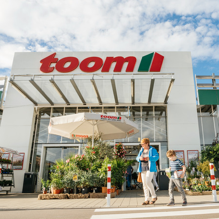 FRANKFURT, GERMANY - JUN 30, 2017: Mother and child walking to the entrance of TOOM the German DIY-store chain offering home improvement and do-it-yourself goods - customers buying goods, selecting the best tools