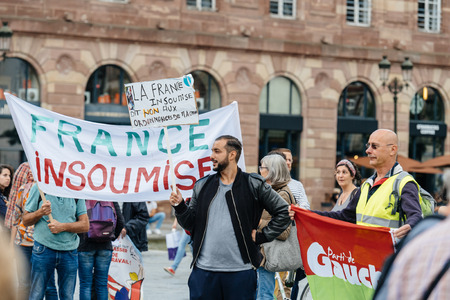 STRASBOURG, FRANCE - JUL 12, 2017: Protesters with placards at protest against Macron government spending cuts and pro-business tax and labor reforms