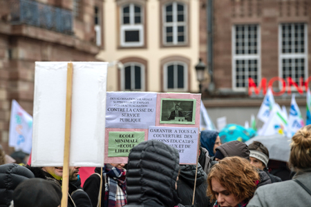 STRASBOURG, FRANCE - MAR 22, 2018: People gathering in Place Kleber square during CGT General Confederation of Labour demonstration protest against Macron French government string of reforms - people with placards in central square
