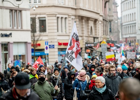 STRASBOURG, FRANCE - MAR 22, 2018: CGT General Confederation of Labour workers with placard at demonstration protest against Macron French government string of reforms - elevated view of crowd