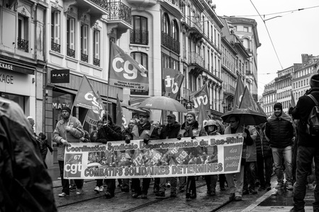 STRASBOURG, FRANCE - MAR 22, 2018: CGT General Confederation of Labour workers with placard at demonstration protest against Macron French government string of reforms - people with large banner combatif solidaires determines