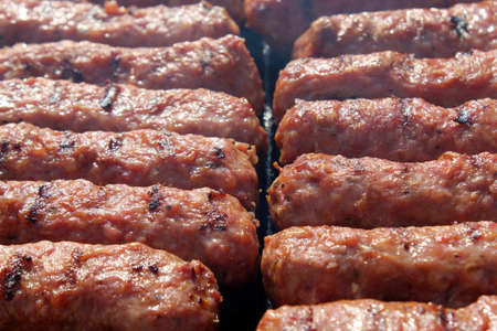 Photo pour Grilled meat rolls, Mici or Mititei, traditional fresh Romanian bbq grill food cooked on the barbeque outside in the nature - image libre de droit